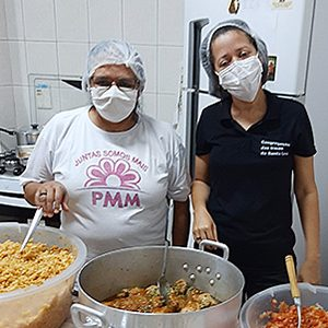 Sisters of the Holy Cross in Brazil, including Sisters Maria de Lourdes de Deus Pimentel, left, and Elizangela Matos dos Santos, serve up 250 hot boxed lunches a week for homeless individuals in São Paulo.
