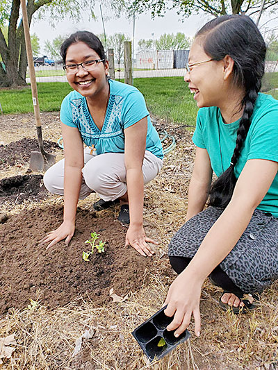 Holy Cross Sisters Rumi Pathang, left, and Sengme Rangsa Marak enjoy caring for the garden and sharing time together.