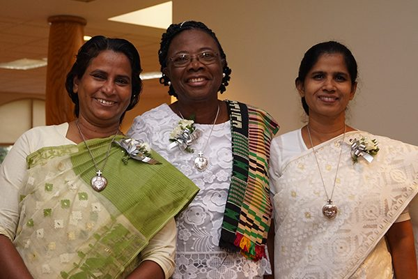 From left, Holy Cross Sisters Shilpi Rozario, Esther Adjoa Entsiwah and Mary Renu Samaddar, rejoiced with one another and for fellow silver jubilarian Sister Mrinalini Goretti Rema, CSC, in Bangladesh, in celebration of their 25-year anniversaries of religious life.