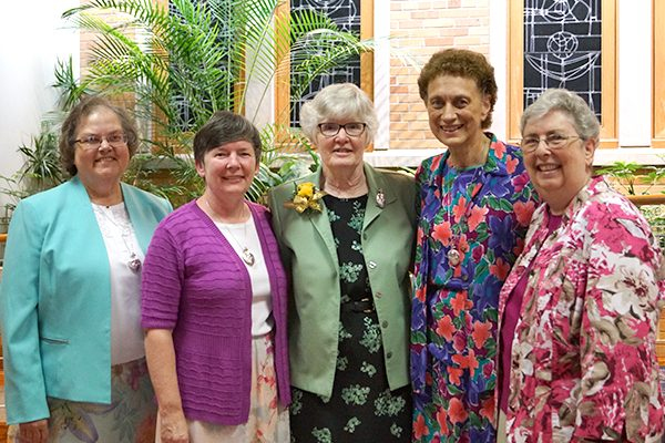 Golden jubilarians Sisters Helene Sharp and Celine Dounies, third and fourth from left, receive congratulations and good wishes from members of the General Leadership Team. From left are Sisters M. Veronique (Wiedower), Congregation president, Sharlet Ann Wagner, first councilor, and at far right, Brenda Cousins, general secretary.